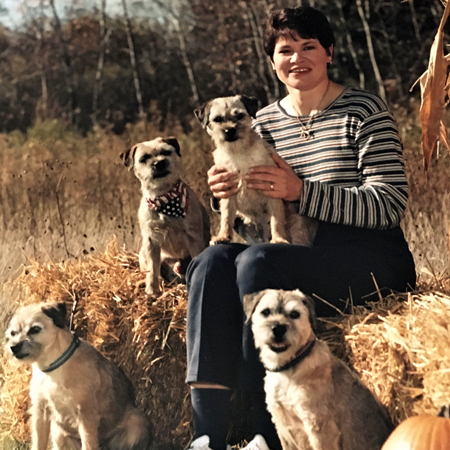 Laurale Stern with Eddie Alyce Ditto and Osca 4 LUVEMUR border terriers with AKC Championship and Utility titles in late 1980s