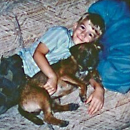 Little boy on the couch with his Border Terrier