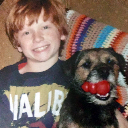 Young boy with his Border Terrier