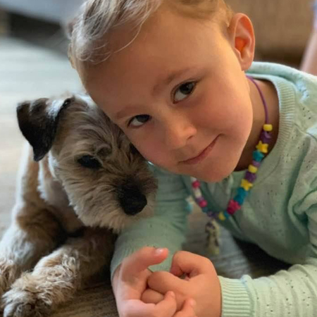 Young girl with her Border Terrier